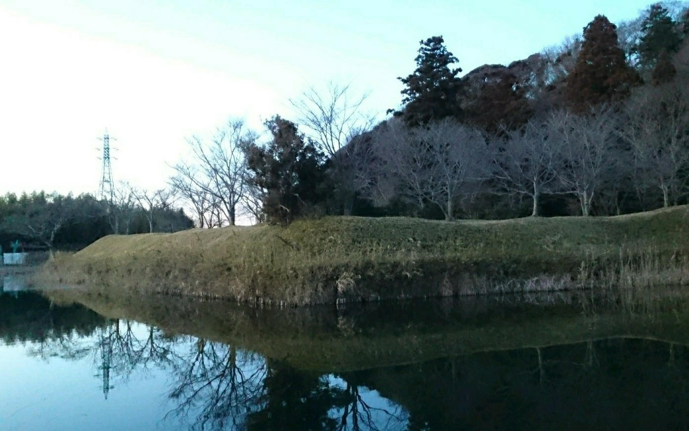 SAKURA Castle Ruins Park:Ruins of Demaru (a fortress projecting from a larger castle)with moats and earthen rampart walls.